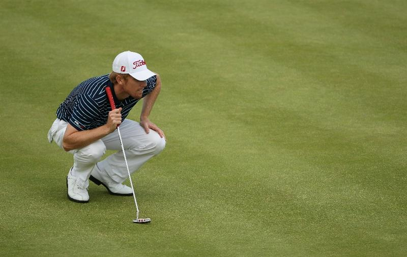NEWPORT, WALES - JUNE 03:  Andrew Dodt of Australia lines up a putt on the 18th hole during the first round of the Celtic Manor Wales Open on The Twenty Ten Course at The Celtic Manor Resort on June 3, 2010 in Newport, Wales.  (Photo by Andrew Redington/Getty Images)