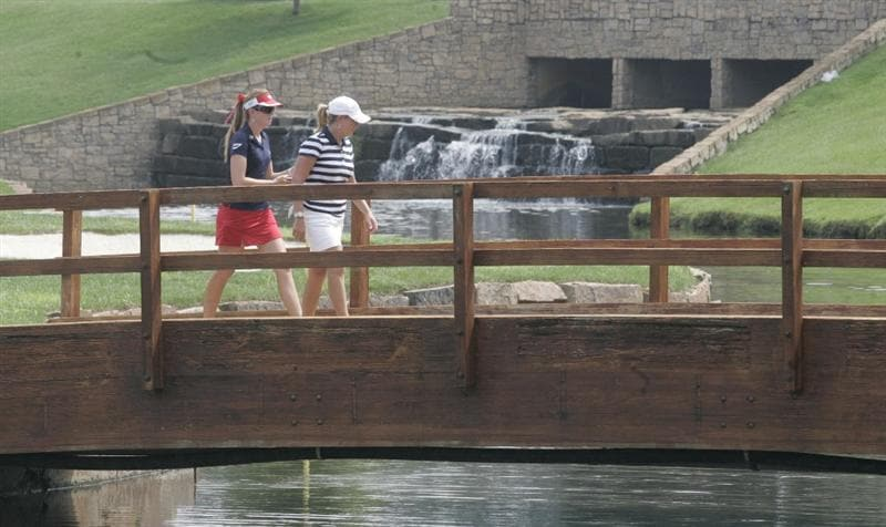 ROGERS, AR - SEPTEMBER 11: Paula Creamer, left, and Christie Kerr walk across the bridge after playing the 15th hole during first round play in the P&G Beauty NW Arkansas Championship at the Pinnacle Country Club on September 11, 2009 in Rogers, Arkansas.  (Photo by Dave Martin/Getty Images)
