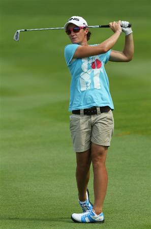 KUALA LUMPUR, MALAYSIA - OCTOBER 20 : Gyladys Nocera of Norway watches her 2nd shot on the 18th hole during the Official Practice on October 20, 2010 at the KLGCC Golf Course in Kuala Lumpur, Malaysia (Photo by Stanley Chou/Getty Images)