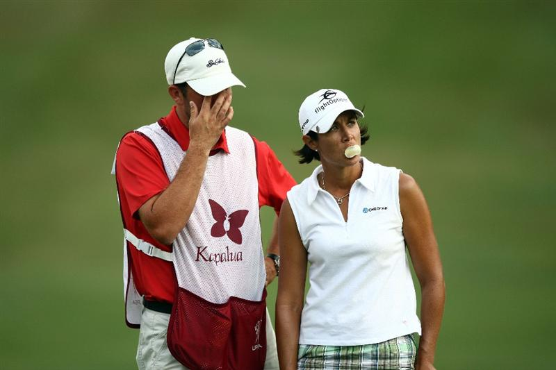 KAPALUA, HI - OCTOBER 18: Laura Diaz look on with caddie on the 18th green during the third round of the Kapalua LPGA Classic on October 18, 2008 at the Bay Course in Kapalua, Maui, Hawaii. (Photo by Donald Miralle/Getty Images)