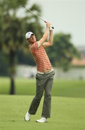 SINGAPORE - NOVEMBER 11:  Chris Wood of England in action during the First Round of the Barclays Singapore Open at Sentosa Golf Club on November 11, 2010 in Singapore, Singapore.  (Photo by Ian Walton/Getty Images)