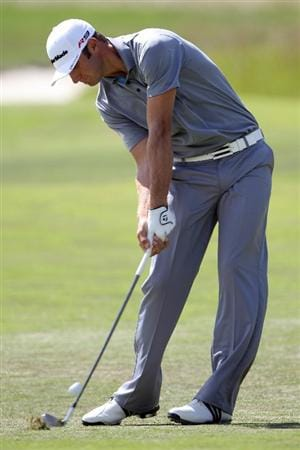 PEBBLE BEACH, CA - JUNE 19:  Dustin Johnson hits a shot from the first fairway during the third round of the 110th U.S. Open at Pebble Beach Golf Links on June 19, 2010 in Pebble Beach, California.  (Photo by Donald Miralle/Getty Images)