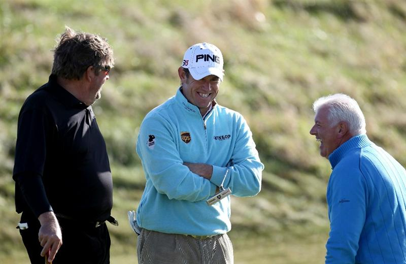 KINGSBARNS, SCOTLAND - OCTOBER 07:  Lee Westwood of England shares a joke with his playing partners Johann Rupert and Gerry McIlroy on the second hole during the first round of The Alfred Dunhill Links Championship at Kingsbarns Golf Links on October 7, 2010 in Kingsbarns, Scotland.  (Photo by Ross Kinnaird/Getty Images)