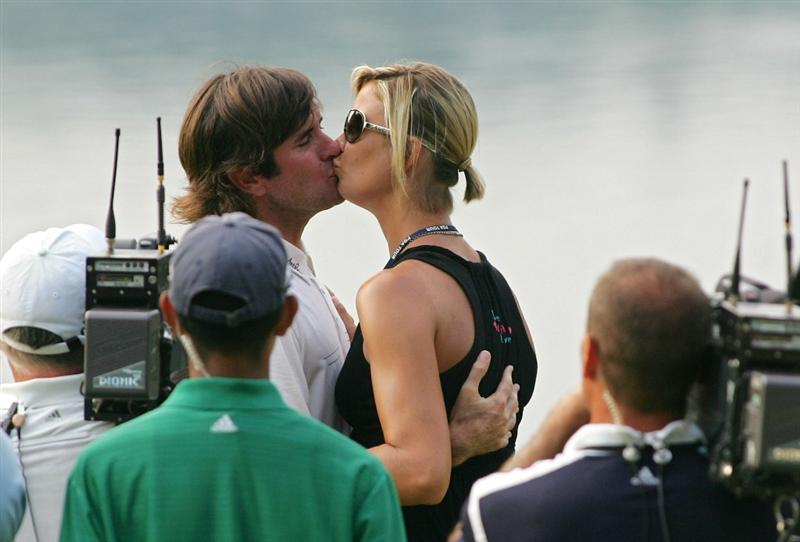 CROMWELL, CT - JUNE 27:  Bubba Watson kisses his wife Angie Watson after winning a two-hole playoff on the 16th green after the final round of the Travelers Championship held at TPC River Highlands on June 27, 2010 in Cromwell, Connecticut.  (Photo by Michael Cohen/Getty Images)