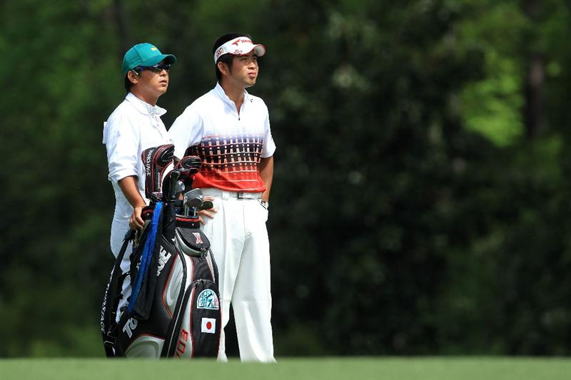 AUGUSTA, GA - APRIL 10:  Yuta Ikeda of Japan waits with his caddie Hisashi Fukuda on the fifth hole during the third round of the 2010 Masters Tournament at Augusta National Golf Club on April 10, 2010 in Augusta, Georgia.  (Photo by David Cannon/Getty Images)