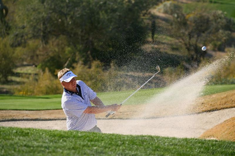 MARANA, AZ - FEBRUARY 18:  Ross McGowan of England hits his third shot out of the bunker on the 18th hole during round two of the Accenture Match Play Championship at the Ritz-Carlton Golf Club on February 18, 2010 in Marana, Arizona.  (Photo by Hunter Martin/Getty Images)