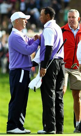 NEWPORT, WALES - OCTOBER 02:  USA Team Captain Corey Pavin congratulates Tiger Woods on the 18th green during the rescheduled Morning Fourball Matches during the 2010 Ryder Cup at the Celtic Manor Resort on October 2, 2010 in Newport, Wales.  (Photo by Jamie Squire/Getty Images)