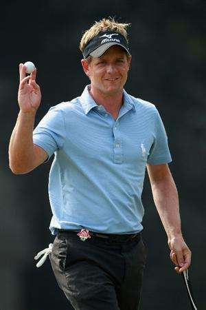 SHANGHAI, CHINA - NOVEMBER 06:  Luke Donald of England waves to the crowd on the fourth hole during the third round of the WGC-HSBC Champions at Sheshan International Golf Club on November 6, 2010 in Shanghai, China.  (Photo by Andrew Redington/Getty Images)