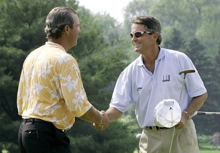 Mark McNulty of Orlando, Florida,  and Tom Purtzer of Scottsdale, Arizona, shake hands when the two tied during the first hole of playoff competion during the 2005 Bank of America Championship at Nashawtuc Country Club in Concord, Massachusetts, Sunday, June 26, 2005.  McNulty won the match with a score of 12-under-par 204 after defeating Tom Purtzer on the second hole of  playoff competition .Photo by Jim Rogash/WireImage.com