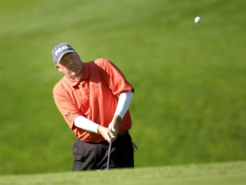 PEBBLE BEACH, CA - FEBRUARY 14: Mark Calcavecchia chips onto the 11th green on Spyglass Hill Golf Course during the third round of the the AT&T Pebble Beach National Pro-Am on February 14, 2009 in Pebble Beach, California. (Photo by Stephen Dunn/Getty Images)