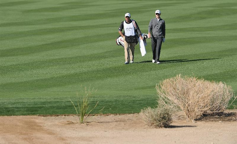 MARANA, AZ - FEBRUARY 24:  Justin Rose of England and caddie walk during the second round of the Accenture Match Play Championship at the Ritz-Carlton Golf Club on February 24, 2011 in Marana, Arizona.  (Photo by Stuart Franklin/Getty Images)