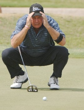 John Jacobs studies a putt on the third  green during   the final  round of the 2005 Blue Angels Class  May 15 in Milton, Fl.Photo by Al Messerschmidt/WireImage.com