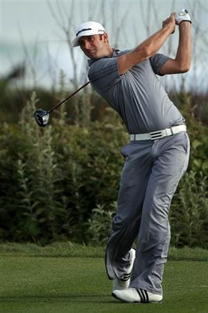 PEBBLE BEACH, CA - JUNE 19:  Dustin Johnson watches his tee shot on the 11th hole during the third round of the 110th U.S. Open at Pebble Beach Golf Links on June 19, 2010 in Pebble Beach, California.  (Photo by Donald Miralle/Getty Images)
