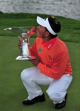 JEJU, SOUTH KOREA - APRIL 26:  Thongchai Jaidee of Thailand holds the trophy after winning in a play - off during the final round of the Ballantine's Championship at Pinx Golf Club on April 26, 2009 in Jeju, South Korea.  (Photo by Stuart Franklin/Getty Images)