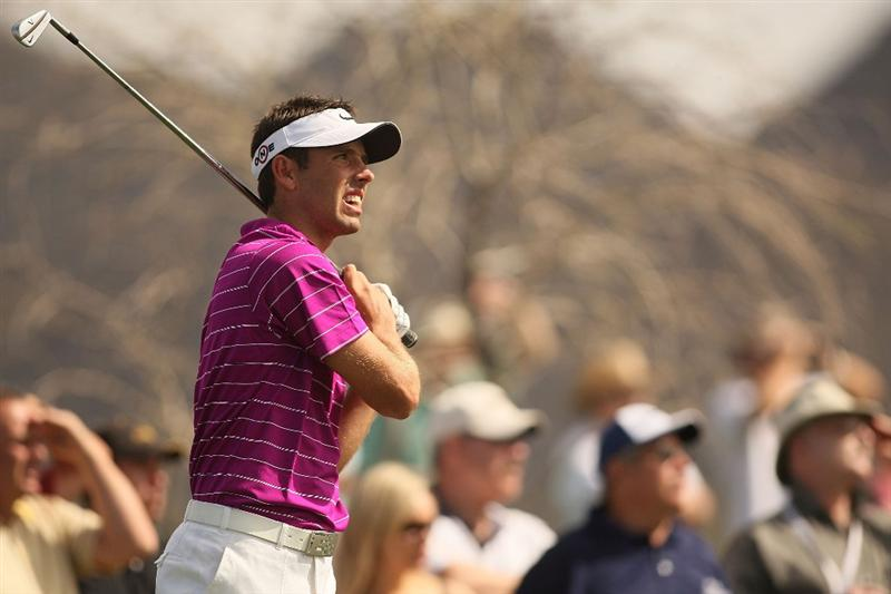 MARANA, AZ - FEBRUARY 19:  Charl Schwartzel of South Africa tees off on the third tee box during round three of the Accenture Match Play Championship at the Ritz-Carlton Golf Club on February 19, 2010 in Marana, Arizona.  (Photo by Darren Carroll/Getty Images)