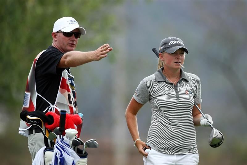 MORELIA, MEXICO- APRIL 23:  Stacy Lewis looks on with her caddie before teeing off the fifth hole during the first round of the 2009 Corona Championship, part of the LPGA Tour, on April 23, 2009 at the Tres Marias Golf Club in Morelia, Michoacan, Mexico. (Photo by Donald Miralle/Getty Images)