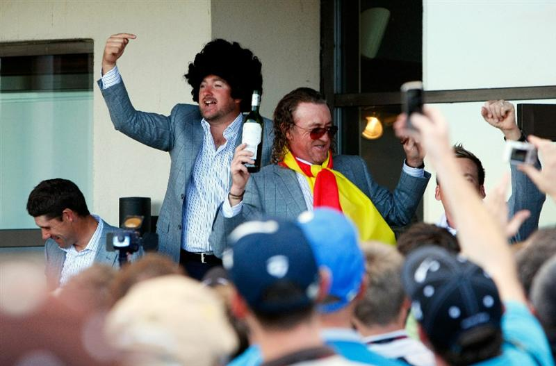 NEWPORT, WALES - OCTOBER 04:  (L-R) European Team members Graeme McDowell and Miguel Angel Jimenez celebrate following Europe's 14.5 to 13.5 victory over the USA at the 2010 Ryder Cup at the Celtic Manor Resort on October 4, 2010 in Newport, Wales.  (Photo by Tom Dulat/Getty Images)