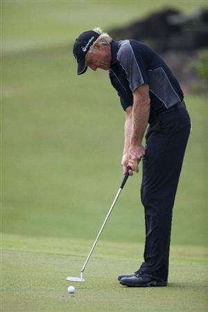 HAIKOU, CHINA - OCTOBER 31: Golfer Greg Norman of Australia plays a shot on 7th hole during day five of the Mission Hills Start Trophy tournament at Mission Hills Resort on October 31, 2010 in Haikou, China. The Mission Hills Star Trophy is Asia's leading leisure liflestyle event which features Hollywood celebrities and international golf stars.  (Photo by Athit Perawongmetha/Getty Images for Mission Hills)