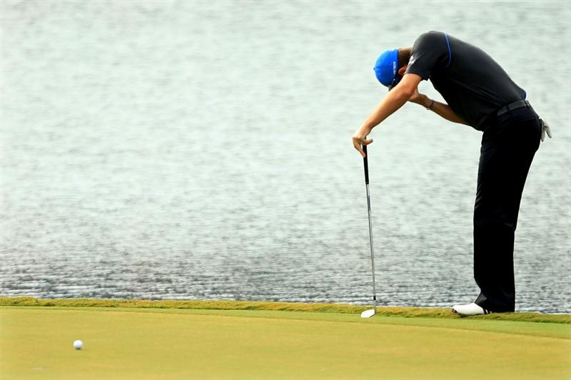 PONTE VEDRA BEACH, FL - MAY 15:  Justin Rose of England reacts to his chip shot on the 17th green during the continuation of the third round of THE PLAYERS Championship held at THE PLAYERS Stadium course at TPC Sawgrass on May 15, 2011 in Ponte Vedra Beach, Florida.  (Photo by Mike Ehrmann/Getty Images)