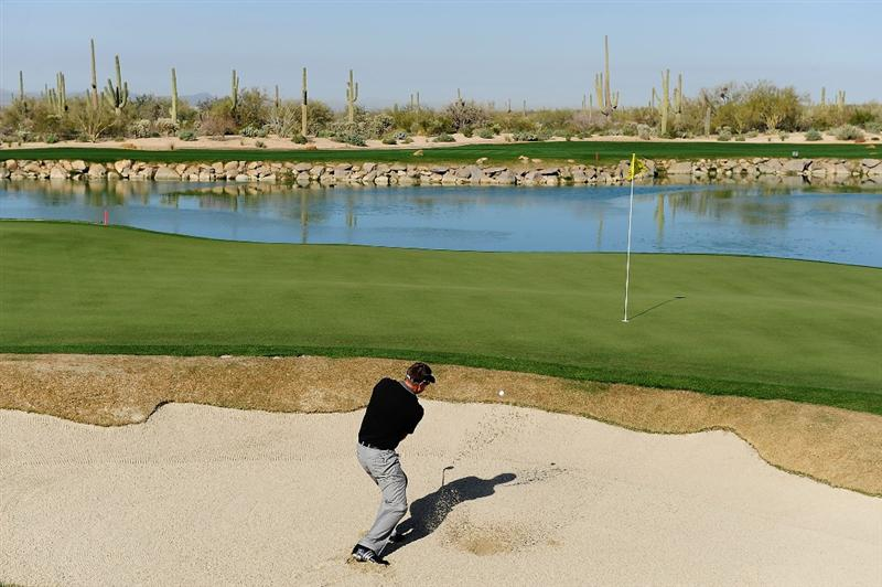 MARANA, AZ - FEBRUARY 18:  Robert Allenby of Australia hits out of the bunker on the third hole during round two of the Accenture Match Play Championship at the Ritz-Carlton Golf Club on February 18, 2010 in Marana, Arizona.  (Photo by Stuart Franklin/Getty Images)