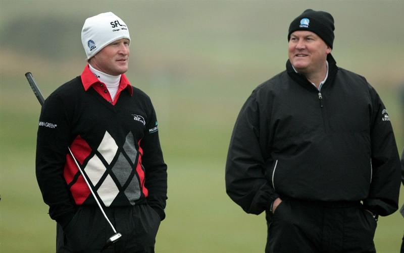 CARNOUSTIE, SCOTLAND - OCTOBER 08:  Jamie Donaldson of Wales with his partner Duane Sutherland at the 4th hole during the second round of The Alfred Dunhill Links Championship at Carnoustie Golf Links on October 8, 2010 in Carnoustie, Scotland.  (Photo by David Cannon/Getty Images)