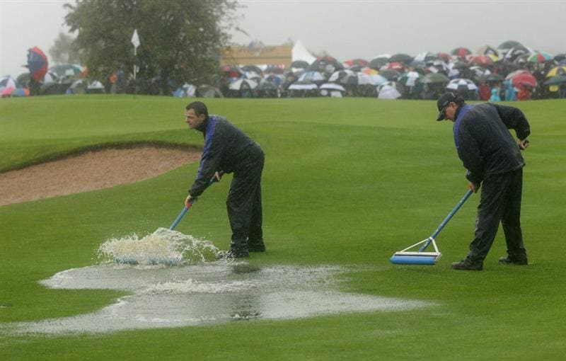 NEWPORT, WALES - OCTOBER 01:  Greenkeepers remove water from a fairway as rain falls during the Morning Fourball Matches during the 2010 Ryder Cup at the Celtic Manor Resort on October 1, 2010 in Newport, Wales.  (Photo by Andrew Redington/Getty Images)