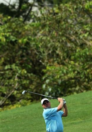 KUALA LUMPUR, MALAYSIA - OCTOBER 29: Carl Pettersson of Sweden wathces his 2nd shot on the 18th hole during day two of the CIMB Asia Pacific Classic at The MINES Resort & Golf Club on October 29, 2010 in Kuala Lumpur, Malaysia. . (Photo by Stanley Chou/Getty Images)
