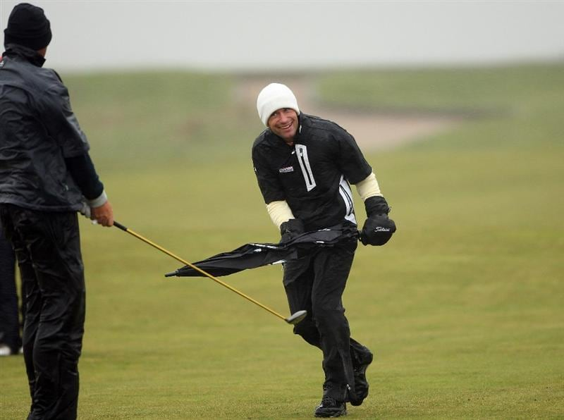 BALTRAY, IRELAND - MAY 16:  Thomas Bjorn of Denmark (left) and Steve Webster of England (right) share a joke in the high winds and rain on the 11th hole during the third round of The 3 Irish Open at County Louth Golf Club on May 16, 2009 in Baltray, Ireland.  (Photo by Andrew Redington/Getty Images)