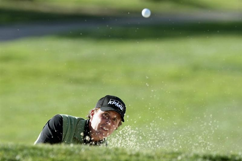 LA JOLLA, CA- JANUARY 26:  Phil Mickelson hits out of the 17th green bunker during the Pro-Am at the Farmers Insurance Open at Torrey Pines on January 26, 2011 in La Jolla, California. (Photo by Donald Miralle/Getty Images)