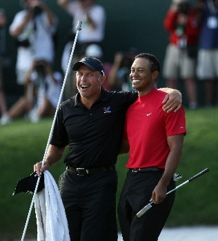 ORLANDO, FL - MARCH 16:  Tiger Woods of the USA stands with his caddie Steve Williams of New Zealand after holing his winning birdie putt at the 18th hole during the final round of the 2008 Arnold Palmer Invitational presented by MasterCard at the Bay Hill Golf Club and Lodge, on March 16, 2008 in Orlando, Florida.  (Photo by David Cannon/Getty Images)
