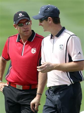 WINDERMERE, FL - MARCH 15:  Brian Davis of England and Justin Rose of England wait to play during the second day of the Tavistock Cup at Isleworth Golf & Country Club on March 15, 2011 in Windermere, Florida.  (Photo by Sam Greenwood/Getty Images)