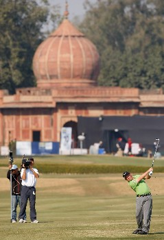 DELHI, INDIA - FEBRUARY 10:  Damien McGrane of Ireland plays his approach shot on the 10th hole during the final round of the Emaar-MGF Indian Masters at the Delhi Golf Club, on February 10, 2008 in Delhi, India.  (Photo by Stuart Franklin/Getty Images)