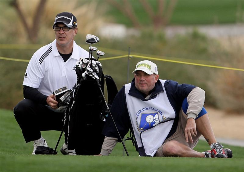 LA QUINTA, CA - JANUARY 20:  Patrick Warburton (L) waits to hit a tee shot on the 13th hole with his caddie during the first round of the Bob Hope Classic at the Silver Rock Resort on January 20, 2010 in La Quinta, California.  (Photo by Jeff Gross/Getty Images)
