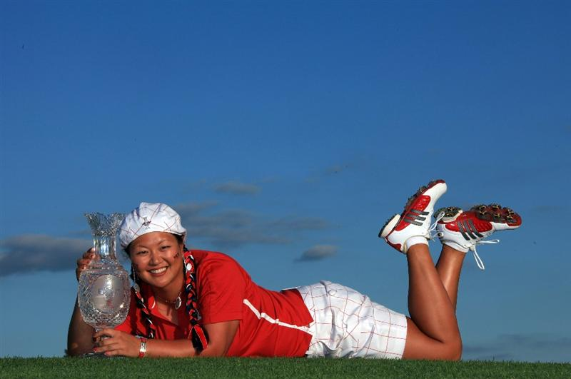 SUGAR GROVE, IL - AUGUST 23: Christina Kim of the USA with the trophy after the Sunday singles matches at the 2009 Solheim Cup Matches, at the Rich Harvest Farms Golf Club on August 23, 2009 in Sugar Grove, Ilinois (Photo by David Cannon/Getty Images)
