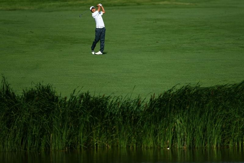 OAKVILLE, ONTARIO - JULY 26 : Anthony Kim plays his second shot on the 18th hole during round three of the RBC Canadian Open at Glen Abbey Golf Club on July 26, 2009 in Oakville, Ontario, Canada.  (Photo by Chris McGrath/Getty Images)