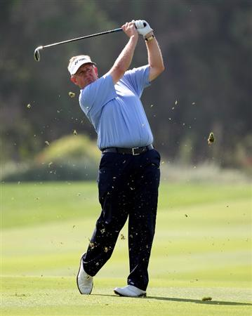 ABU DHABI, UNITED ARAB EMIRATES - JANUARY 23:  Colin Montgomerie of Scotland during the third round of the Abu Dhabi Golf Championship at the Abu Dhabi Golf Club on January 23, 2010 in Abu Dhabi, United Arab Emirates.  (Photo by Ross Kinnaird/Getty Images)