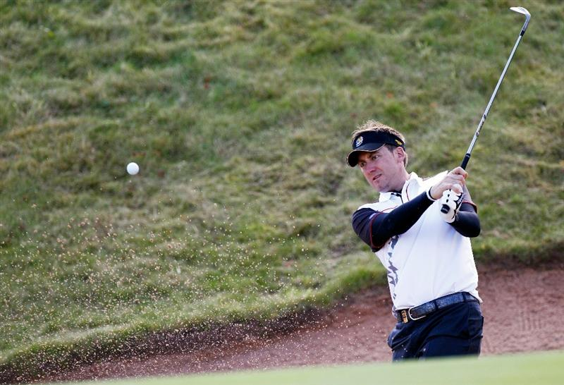 NEWPORT, WALES - SEPTEMBER 28:  Ian Poulter of Europe hits from a bunker during a practice round prior to the 2010 Ryder Cup at the Celtic Manor Resort on September 28, 2010 in Newport, Wales.  (Photo by Sam Greenwood/Getty Images)
