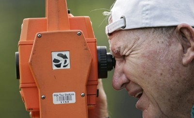 A volunteer records measurements for ShotLink during the first round of the Mercedes-Benz Championship held on the Plantation Course at Kapalua in Kapalua, Maui, Hawaii, on January 4, 2007. PGA TOUR - 2007 Mercedes-Benz Championship - First RoundPhoto by Sam Greenwood/WireImage.com