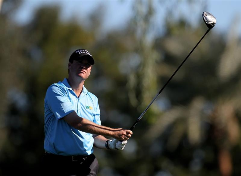 LA QUINTA, CA - JANUARY 24:  Joe Ogilvie watches his tee shot on the 13th hole at La Quinta Country Club during the fourth round of the Bob Hope Classic on January 24, 2010 in La Quinta, California.  (Photo by Stephen Dunn/Getty Images)