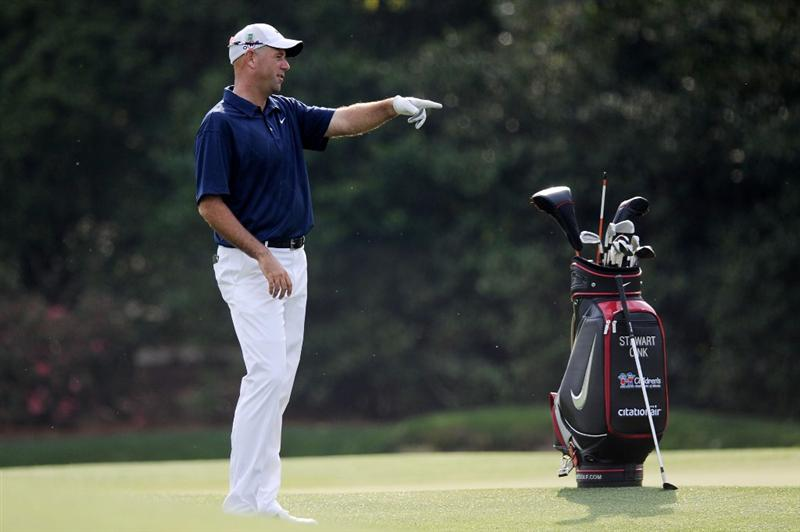 AUGUSTA, GA - APRIL 07:  Stewart Cink points while alongside his bag during a practice round prior to the 2010 Masters Tournament at Augusta National Golf Club on April 7, 2010 in Augusta, Georgia.  (Photo by Harry How/Getty Images)