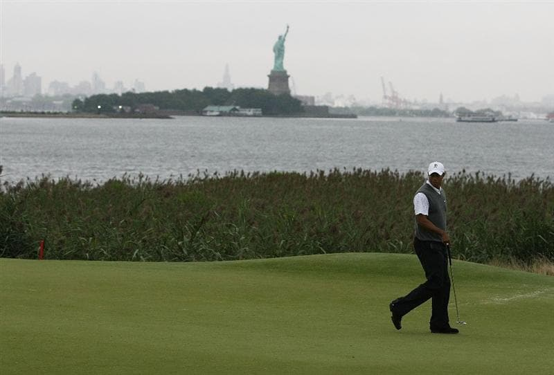 JERSEY CITY, NJ - AUGUST 28:  Tiger Woods walks across the green on the 14th hole during round two of The Barclays on August 28, 2009 at Liberty National in Jersey City, New Jersey.  (Photo by Nick Laham/Getty Images)