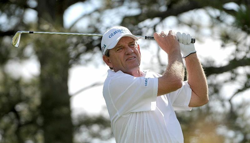 PARKER, CO. - MAY 28: Nick Price hits his tee shot  to the par three 11th hole during the second round of the Senior PGA Championship at the Colorado Golf Club on May 28, 2010 in Parker, Colorado.  (Photo by Marc Feldman/Getty Images)