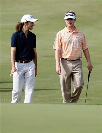 LAS VEGAS - OCTOBER 14:  Saxophonist Kenny G (L) and golfer David Toms walk towards the 8th green during the Justin Timberlake Shriners Hospitals for Children Open Championship Pro-Am at the TPC Summerlin October 14, 2009 in Las Vegas, Nevada.  (Photo by Ethan Miller/Getty Images)