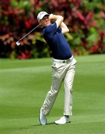 KUALA LUMPUR, MALAYSIA - OCTOBER 28: Andrew Dodt of Australia plays his 2nd shot on the 1st hole during day one of the CIMB Asia Pacific Classic at The MINES Resort & Golf Club on October 28, 2010 in Kuala Lumpur, Malaysia. (Photo by Stanley Chou/Getty Images)
