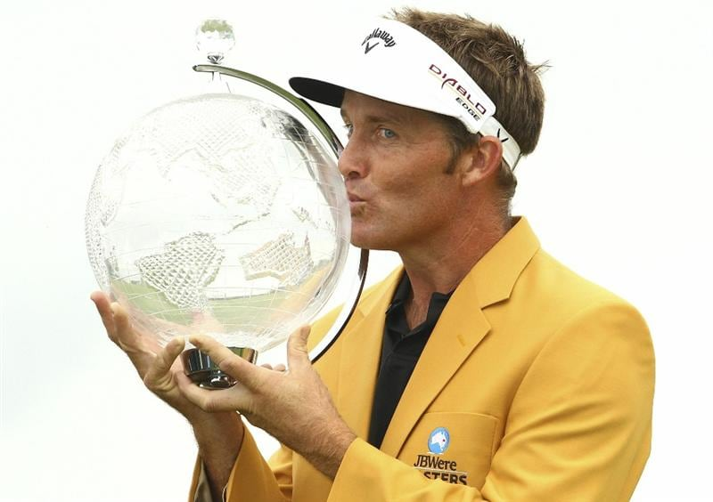 MELBOURNE, AUSTRALIA - NOVEMBER 14:  Stuart Appleby of Australia kisses the trophy after winning the 2010 Australia Masters after round four of the Australian Masters at The Victoria Golf Club on November 14, 2010 in Melbourne, Australia.  (Photo by Lucas Dawson/Getty Images)