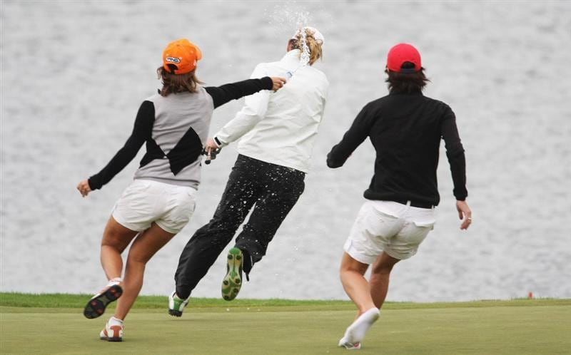 CHRISTCHURCH, NEW ZEALAND - FEBRUARY 01:  Gwladys Nocera of France is chased by friends after winning the New Zealand Women`s Open held at Clearwater Golf Course February 1, 2009 in Christchurch, New Zealand.  (Photo by Sandra Mu/Getty Images)