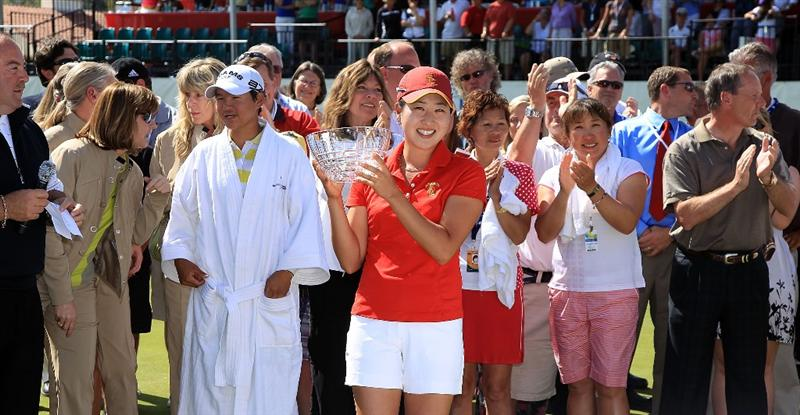 RANCHO MIRAGE, CA - APRIL 04: Jennifer Song of the USA with her trophy for leading amateur during the final round of the 2010 Kraft Nabisco Championship, on the Dinah Shore Course at The Mission Hills Country Club, on April 4, 2010 in Rancho Mirage, California.  (Photo by David Cannon/Getty Images)