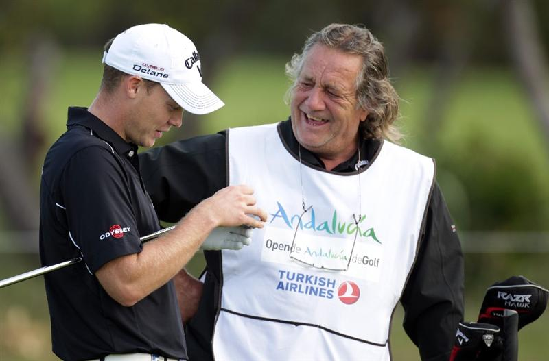 MALAGA, SPAIN - MARCH 24:  Danny Willett of Englan and his caddie Malcolm Mason during the first round of the Open de Andalucia at the Parador de Malaga Golf Course on March 24, 2011 in Malaga, Spain.  (Photo by Ross Kinnaird/Getty Images)