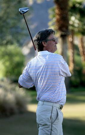 LA QUINTA, CA - JANUARY 23:  Actor Kurt Russell hits his tee shot on the ninth hole on the Nicklaus Private course at PGA West during the third round of the Bob Hope Classic on January 23, 2010 in La Quinta, California.  (Photo by Stephen Dunn/Getty Images)