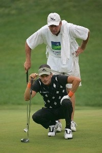 Jesper Parnevik lines up a shot with his caddie during the second round the 2006 Wachovia Championship at the Quail Hollow Club in Charlotte, North Carolina on May 5, 2006.Photo by Sam Greenwood/WireImage.com